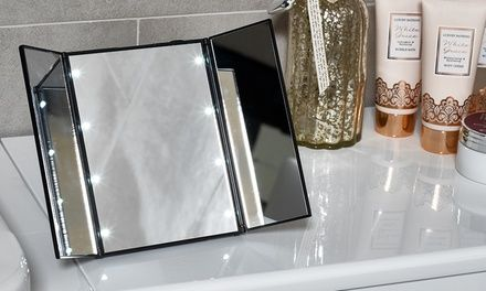 This tri-fold mirror has eight LED lights and is designed to show much more angle of the face then a regular mirror