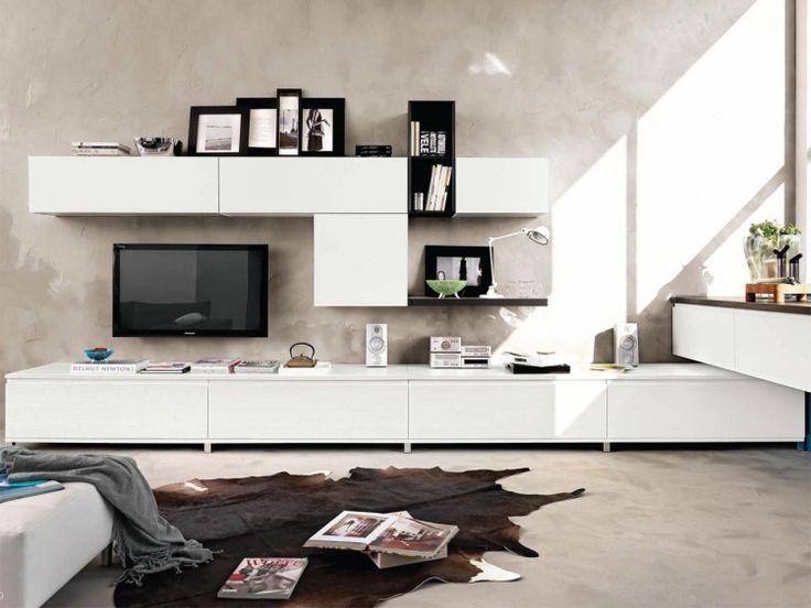 meuble de salon blanc et élégant avec des cadres photos noirs