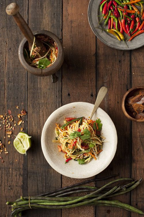 """Green papaya salad - Traditional Thai or Lao dish called """"Tam Som"""". Very popular dish for any time of the day and something you shouldn't miss when traveling Thailand!"""