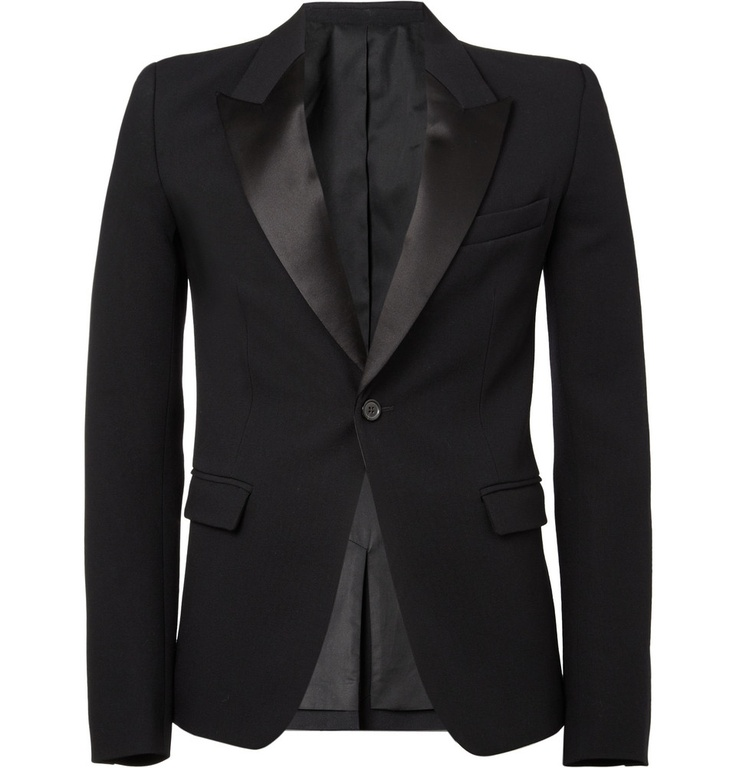 Balmain's slick style translates effortlessly into evening attire with this black tuxedo jacket. Tailored from thickly woven wool and with silk peaked lapels, this close-fitting piece exudes rakish attitude.