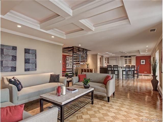 Large Living Room Accommodates Plenty Of Seating Areas