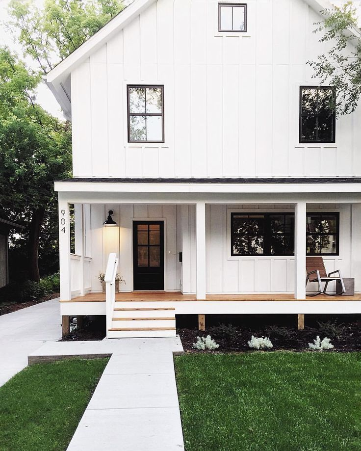 farmhouse- white palette exterior, porch, black rims and frames for doors and windows