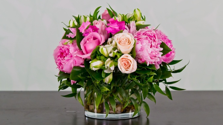 fresh assorted flowers in a low cylinder vase....app florista2