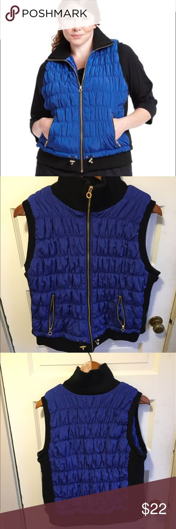 Calvin Klein blue vest with smartphone pocket This vest is very stretchy and comfortable. Dense and well made. Great condition Calvin Klein Jackets & Coats Vests