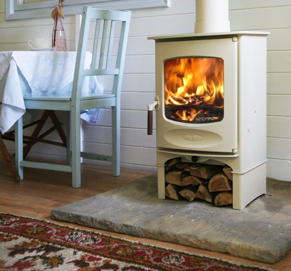White wood burning stove -- I like the rock underneath.