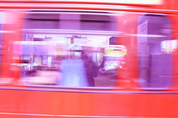 Selhurst street photography, moving bus capturing reflection of street.