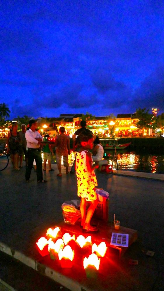 Paper lanterns for sale at night in Hoi An, Vietnam - you release these into water!