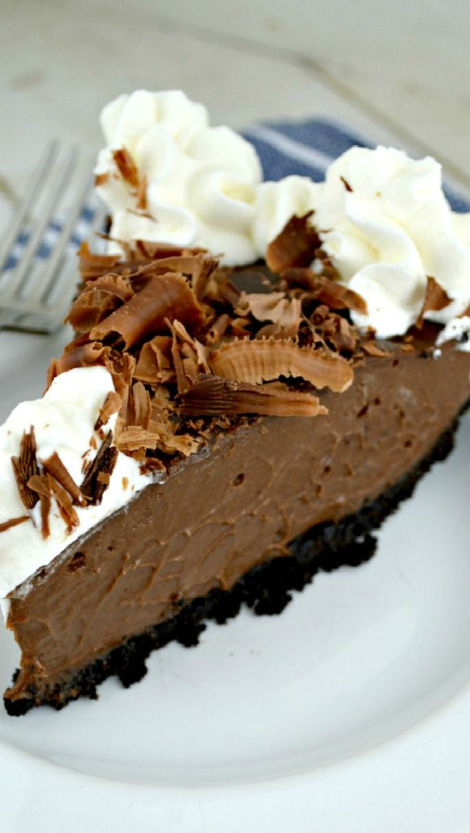 Decadent Chocolate Cream Pie enhanced with a generous splash of rum set in a yummy chocolate crumb crust and topped with chocolate curls and just a bit of rum spiked homemade whipped cream
