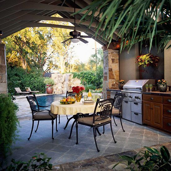Outdoor Kitchen. An outdoor kitchen with a grill, sink, and refrigerator makes poolside living even easier. A ceiling fan circulates air, keeping the kitchen cool, and lighting allows dining to go late into the night.