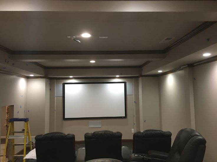 Small Home Theater in traditional design with a BenQ projector and Draper Clarion Screen, 7.2 Surround sound with ButtKicker on Theater Seating, all LED lighting and BitWise control.