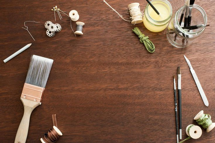 Free Stock Photo: Random paint brushes, spools, knife and jars as frame around copy space on wooden table background - By freeimageslive contributor: gratuit