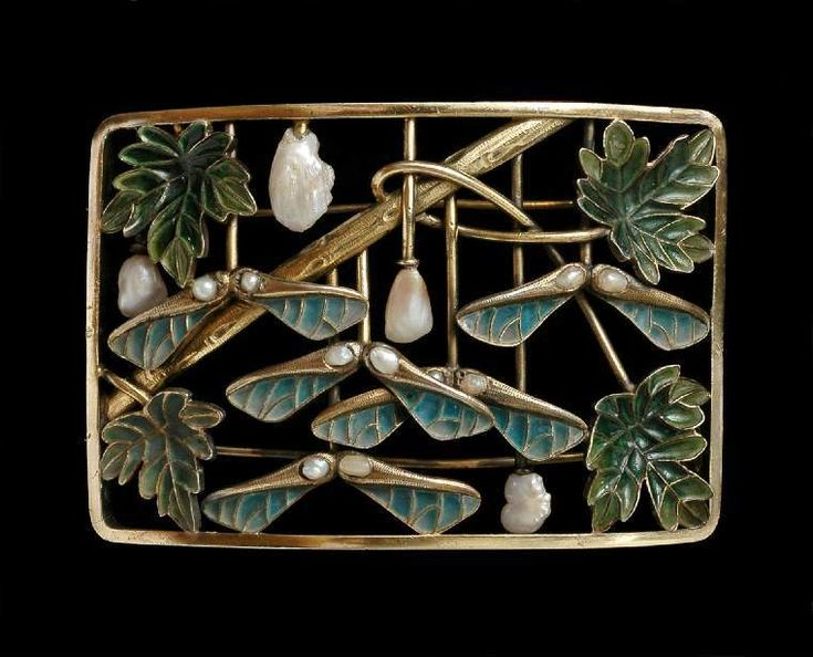 Collier de chien plaque de cou, Gold, turquoise and green plique-à-jour enamels, and baroque pearls. Of convex rectangular form with two pin fastenings across the back. The frame encloses an arrangement of a diagonal branch, four sycamore leaves, five winged sycamore seed pods on vertical stems, and four baroque pearls mounted on vertical stems; paris of smaller pearls are set in each of the winged seed pods. Circa 1900