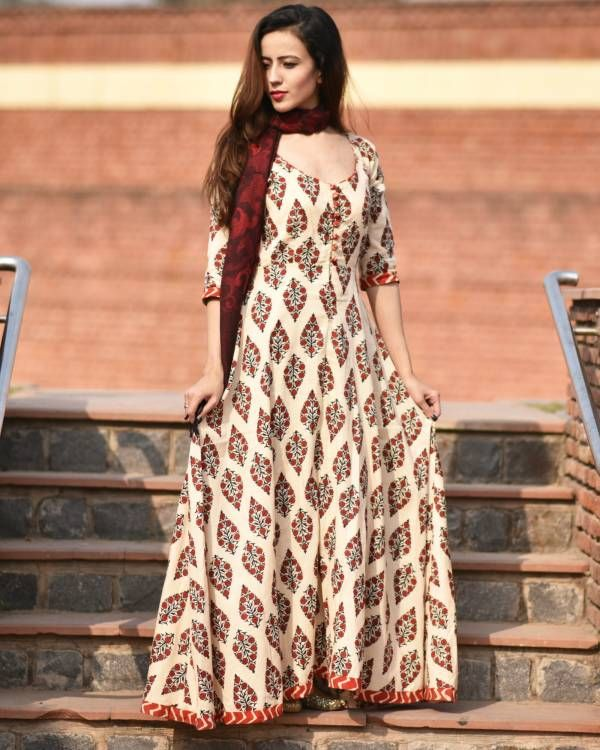 Red rajasi dress    Florals can never go out of fashion. This flowy and feminine maxi dress features geometric border at hem and sleeves. The in-house handcrafted buttons add to the charm of the dress. Wear it with a boho necklace and boots for a funky contrast