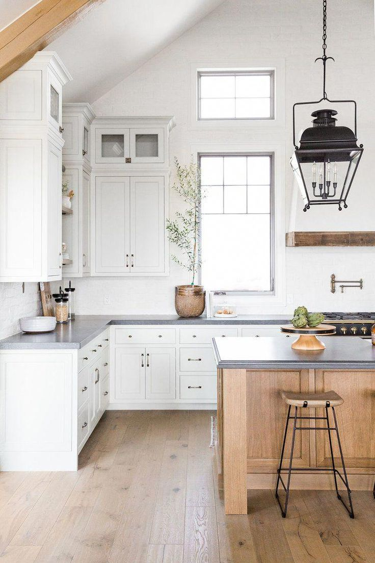 Refined, rustic kitchen with exposed wooden beams, hanging