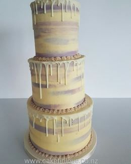 """This was a yummy 10"""" carrot cake with cream cheese Italian meringue buttercream, 8"""" chocolate cake filled with chocolate ganache and a 6"""" lemon cake filled with lemon curd. All tiers were covered in vanilla Italian meringue buttercream and a white chocolate drip. This cake stood 19"""" tall. #cakesnorthland  #weddingsnorthland  #italianmeringuebuttercream  #carrotcake  #chocolatecake  #lemoncake  #cakeswhangarei  #caketinlove"""