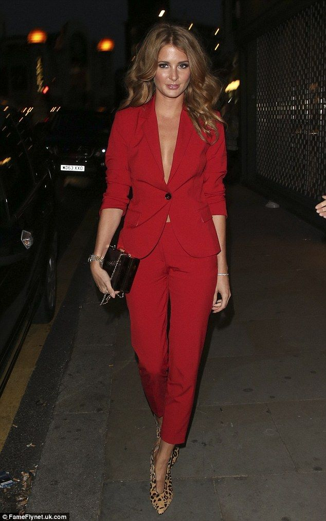Suits you: Millie Mackintosh arrives for the Samsung Galaxy Alpha launch party in a red ja...