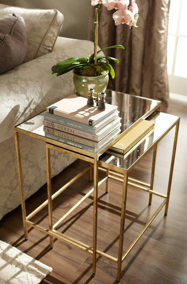 Interior design trends: Gold. Ethan Allen mirror top golden side tables.