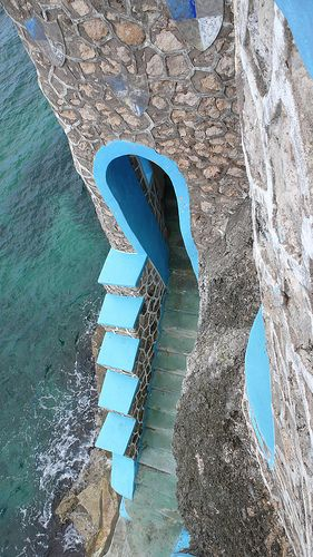 Blue Cave Castle, Negril, Jamaica was built 50 ft above an old pirate's cave on the Caribbean