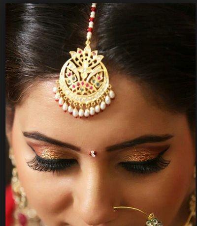 Mang tika designs for Indian brides 8