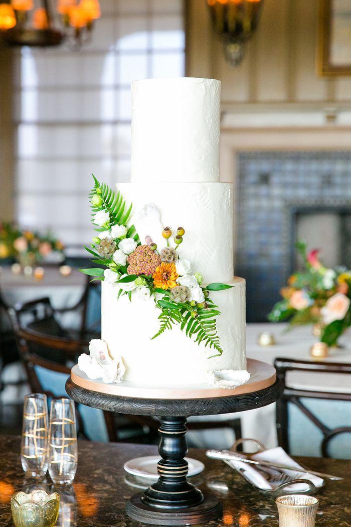 Yellow and white tiered wedding cake #cake #weddingcake