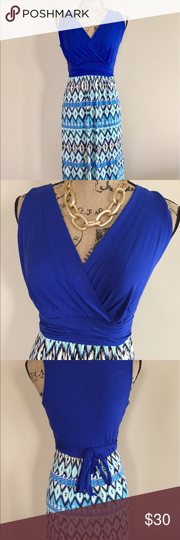 """Royal and aqua blue maxi dress Beautiful maxi dress has a royal blue surplice top with a royal, aqua, and white Aztec print skirt. Banded under bust for shaping with attached sash to tie back. 96% rayon 4% spandex. Size S(0/2-bust 15"""", length 56""""), M(4/6-bust 17"""", length 57""""), L(8/10-bust 18"""", length 59""""). **I'm 5'9"""" 34D modeling the S. Dresses Maxi"""