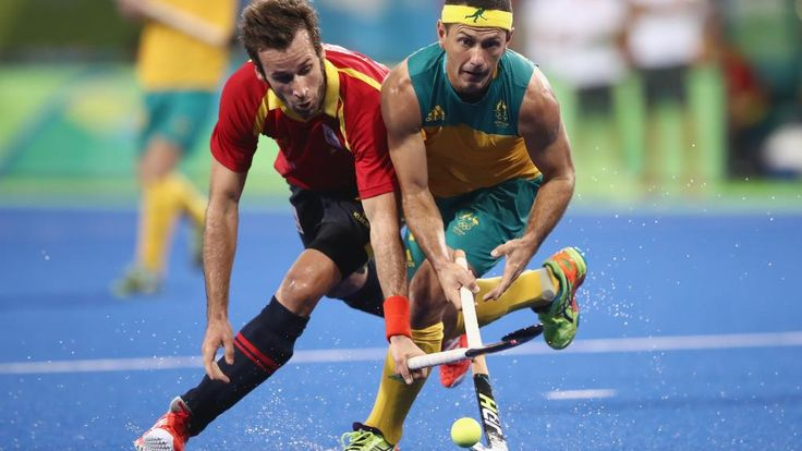 RIO DE JANEIRO, BRAZIL — AUGUST 07: David Alegre of Spain and Jamie Dwyer of Australia compete for the ball during the men's pool A match between Brazil and Belgium on Day 2 of the Rio 2016 Olympic Games at the Olympic Hockey Centre on August 7, 2016 in (1023×576)