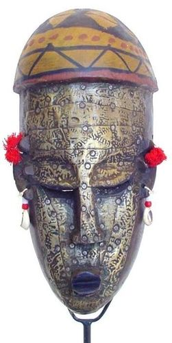 Africa |  Marka or Bambara mask | Mali or Burkina Faso | A wooden face mask, metal plated with red tassle and shell details