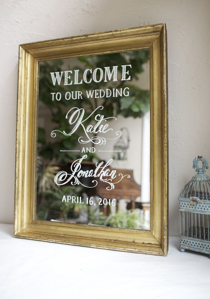 Antique gold framed mirror. Custom painted wedding wecome. This beautiful mirror is a family heirloom of the bride, cherished now as a handpainted sign to honor her family and celebrate the special day. We can paint any sign that you deliver or ship to us.