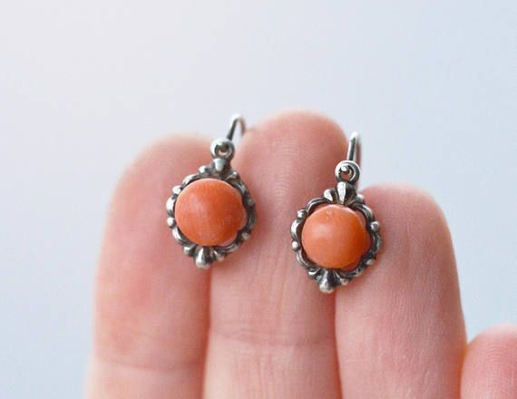 This is a rare antique biedermeier (Victorian period) genuine natural salmon coral earring made out of 835 purity sterling silver. Europian or Russian made. Amazing, slightly freeform rounded 6 mm wide coral sitting on the floral design earring. The closure is the old style when the hook
