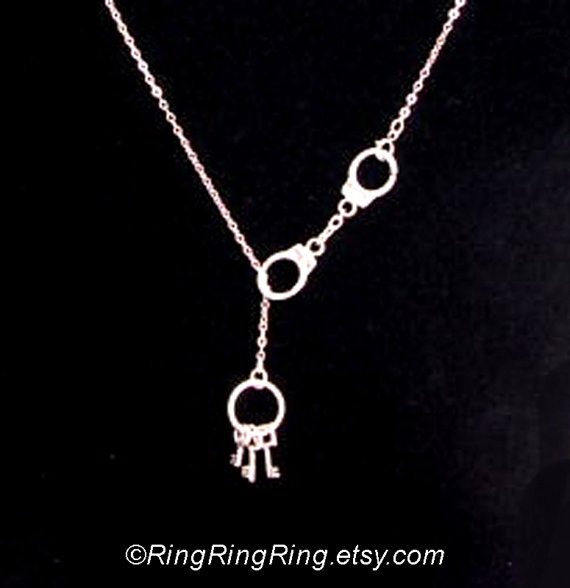 handcuffs and keys necklace.