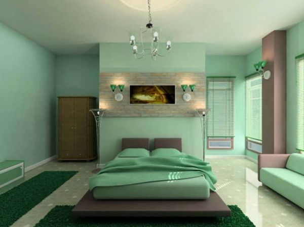 une couleur verte pâle dans une chambre à coucher avec des lampes vertes er un paneau brun au-dessus du lit marron
