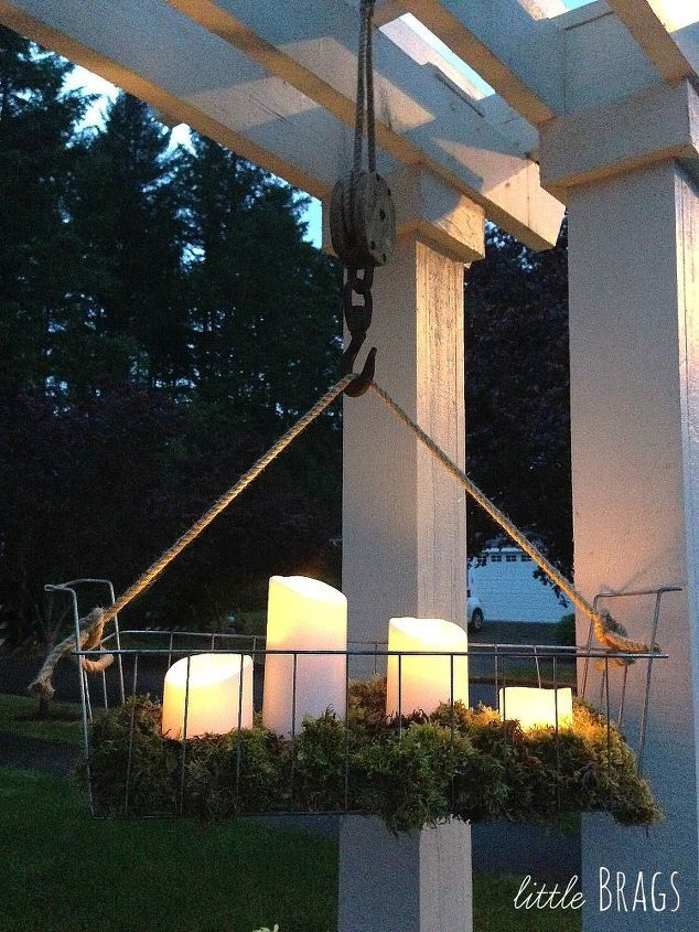Battery powered candles outside diy hanging wire basket on an old pulley, container gardening, crafts, diy