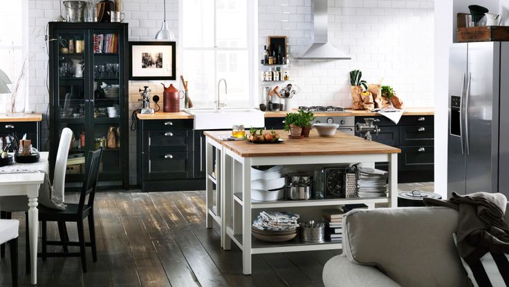 Back to back kitchen islands and a glass door cabinet in an open spaced kitchen