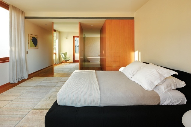 Movement in and through this room is past the foot of the bed, which helps with a feeling of spaciousness. The main bedroom ensuite is entered via a passage off the wardrobe.