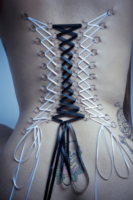 Corset piercing. I've had a strange liking for them for a while now, but I don't know if I could get one!