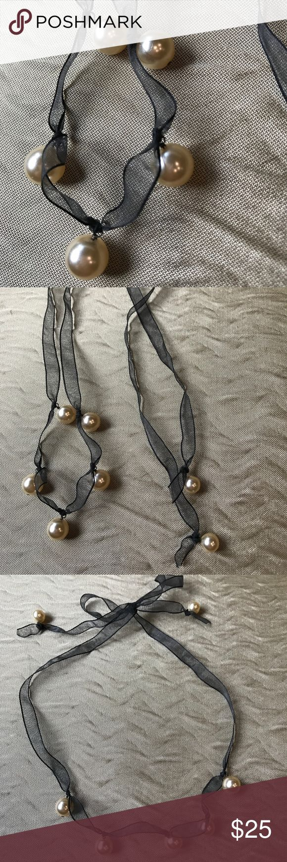 J Crew pearl necklace J Crew pearl necklace on a black sheer ribbon.  Very beautiful necklace, in excellent condition.  Only worn a few times J crew Jewelry Necklaces