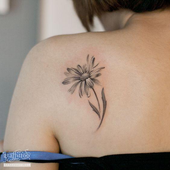 Black And Grey Daisy Flower Tattoo On Women Left Back Shoulder
