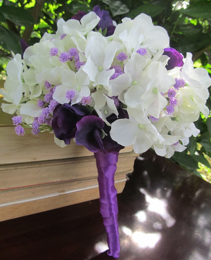White hydrangeas purple sweet peas and lavender wedding