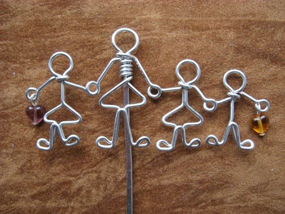 This is a cute teacher or mother with kids bookmark. This design was created by drawing it first and then, with a LOT of practice, making it with the wire. #handmade #crafts