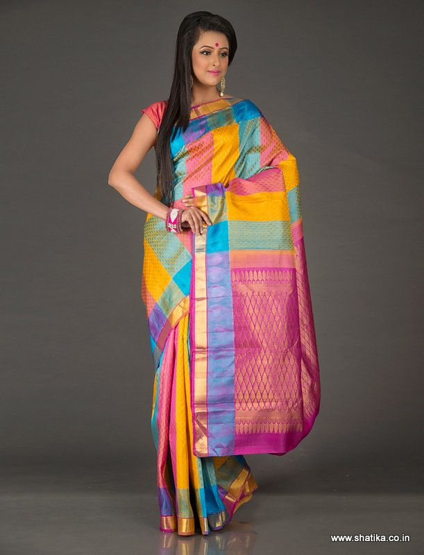 Considered to be a trendsetter in today's fashion circuit is Chinnamastika Multicolored Stripes Pure Kanjivaram Silk Saree with woven Mango Design. With cutting edge design and modish colors, it sets the ball rolling for Kanjeevaram silk sarees' trends in twenty-first century. The extensive zari work seen on the pallu and border is done using 100% pure silver dipped in gold.