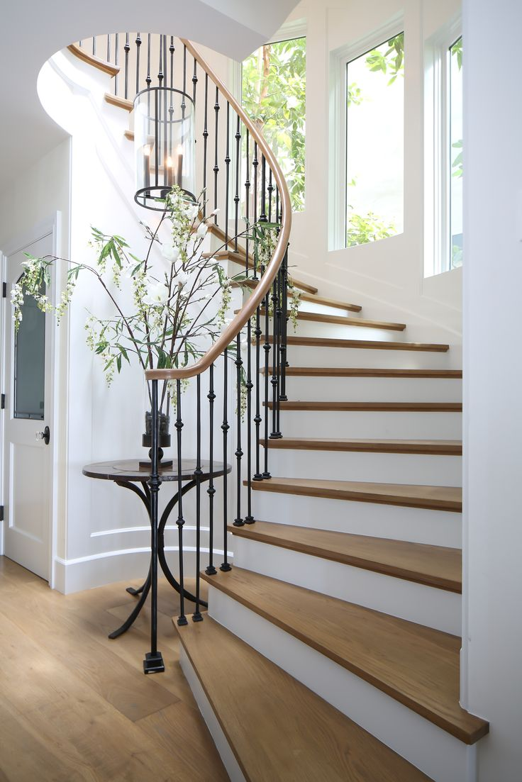 This staircase has the advantage of a lot of natural lighting. There is a skylight above it and windows going up beside it. So much lighting is definitely needed for such a lovely staircase, though!
