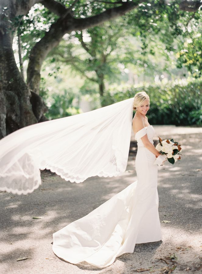 Off-the-shoulder Austin Scarlett wedding gown: http://www.stylemepretty.com/2016/12/20/citrus-infused-florida-wedding/ Photography: Jacqui Cole - http://jacquicole.com/
