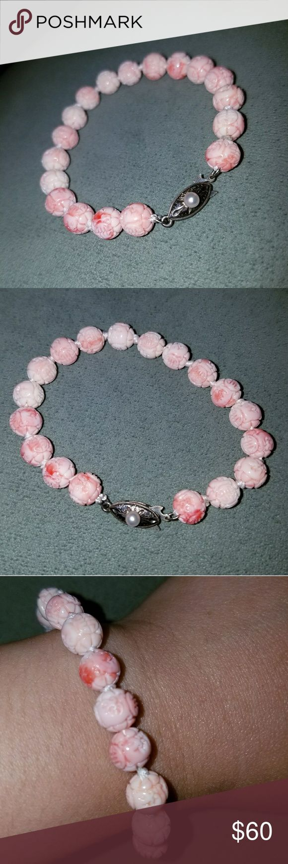 Carved coral pink conch shell pearl bracelet Carved natural pink conch shell bead bracelet with pearl and silver clasp. In excellent condition with no crack. Looks very close to angel skin coral beads. PRICE FIRM Vintage Jewelry Bracelets