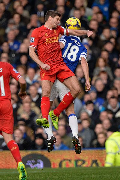 There's more argy-bargy in the 2013 Merseyside derby as Steven Gerrard leads with his elbow as he goes up for a  header with Gareth Barry.