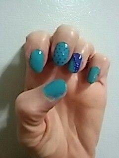 Super cute dimond and polka dot nails!