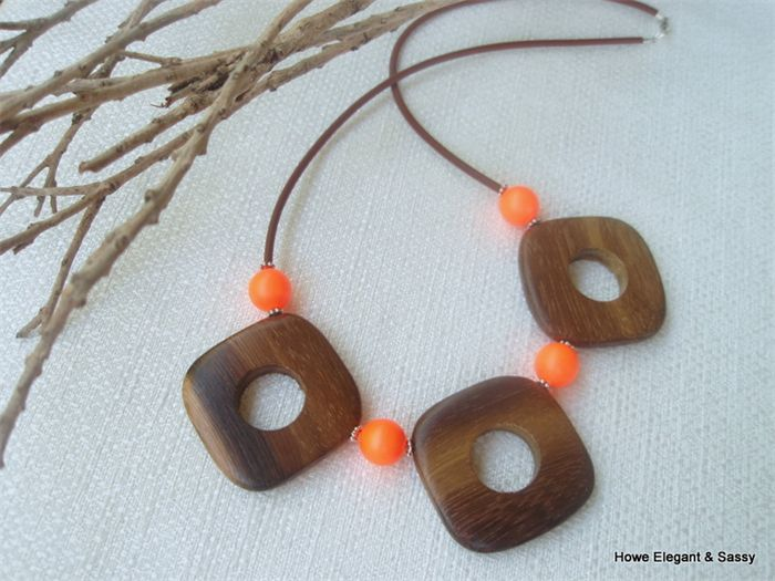 I love how the wooden beads earth the pop of orange.  A perfect necklace to brighten up your wardrobe!  Swarovski Neon Orange pearls, Wood, Sterling Silver, necklace