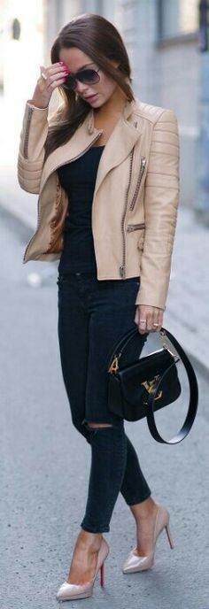Neutral leather jacket over all black