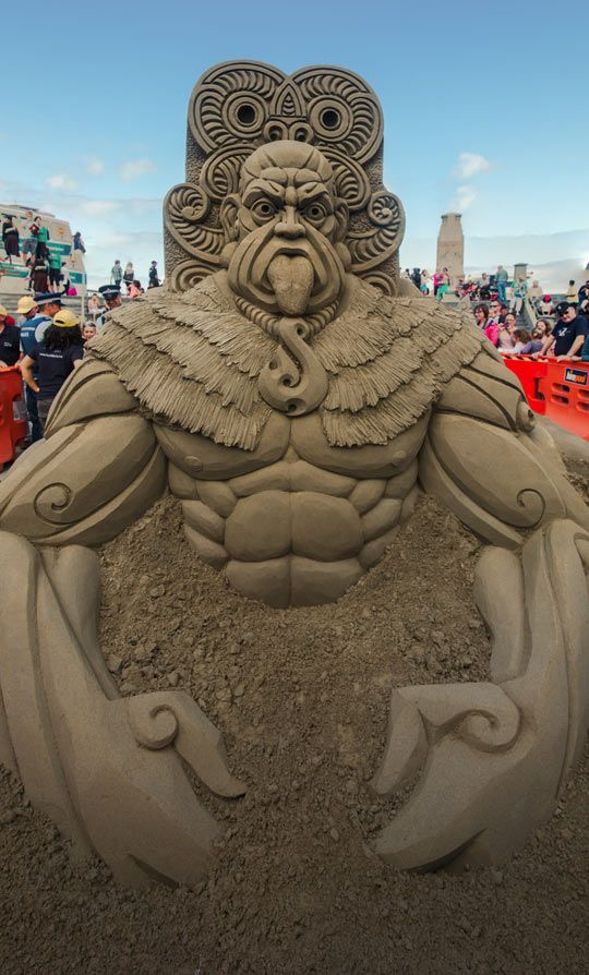 Sand sculpture at the NZ Sandcastle Competition . . . is that his chin or is he sticking his tongue out ?