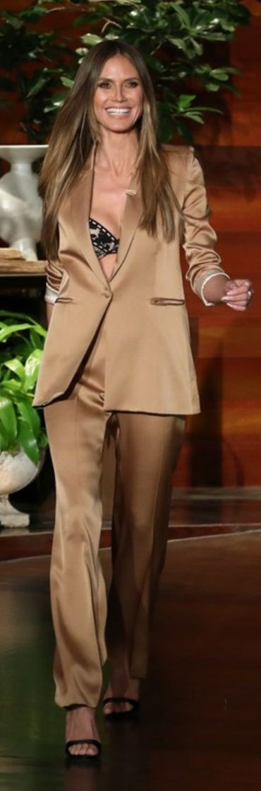 Who made  Heidi Klum's jewelry, tan pants suit, black sandals, and underwear?