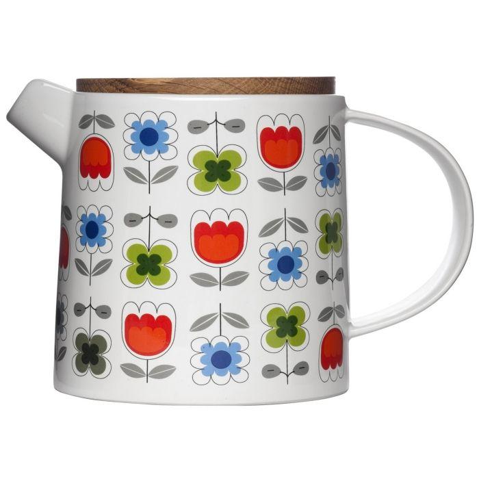 Tradiční porcelánová konvice na čaj o objemu 1,2 litru s dřevěným víkem. Konvice je určena na servírování na tácu (není součástí).